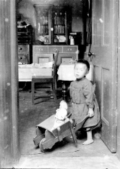 1908 Kate Ritchie with doll in barrow